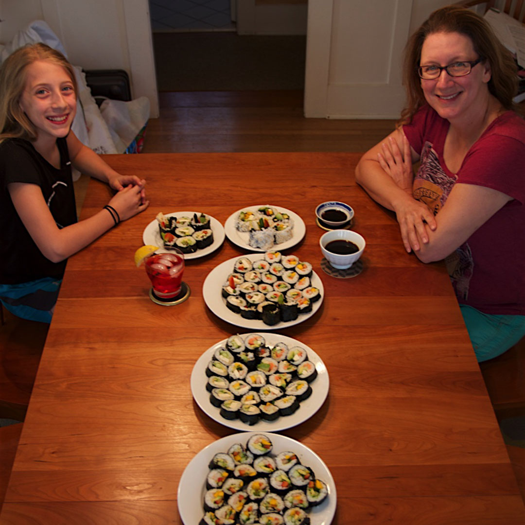 Bellevue fertility specialist Dr. Angela Thyer eating sushi with her daughter